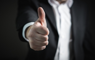 thumbs up business man suit pixabay